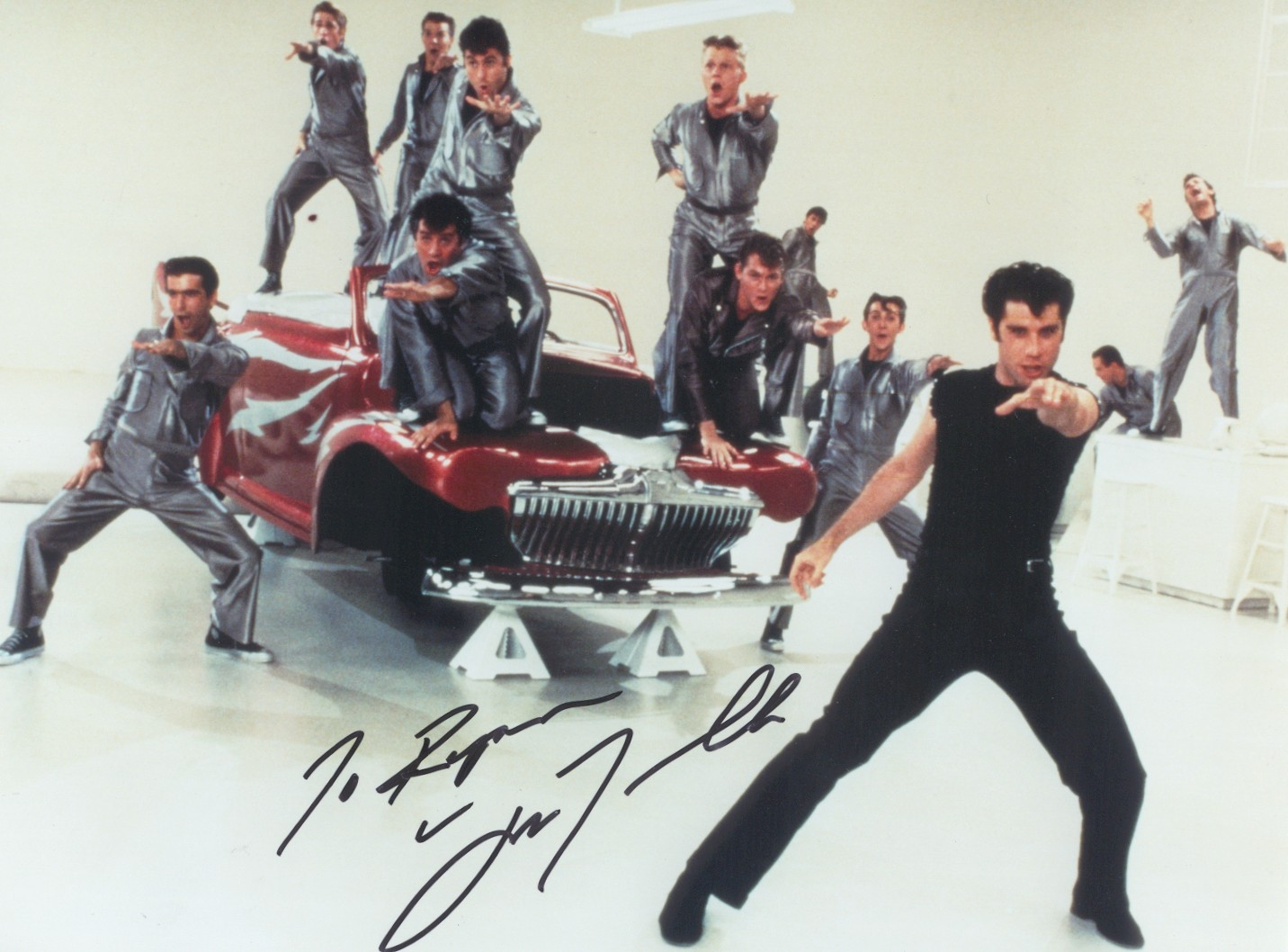 http://sigsofsuccess.files.wordpress.com/2010/12/john-travolta-grease-lightning.jpg